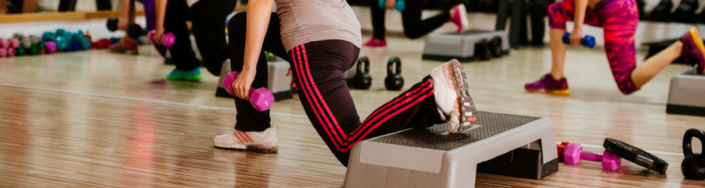 Women in fitness clothes doing a group exercise class