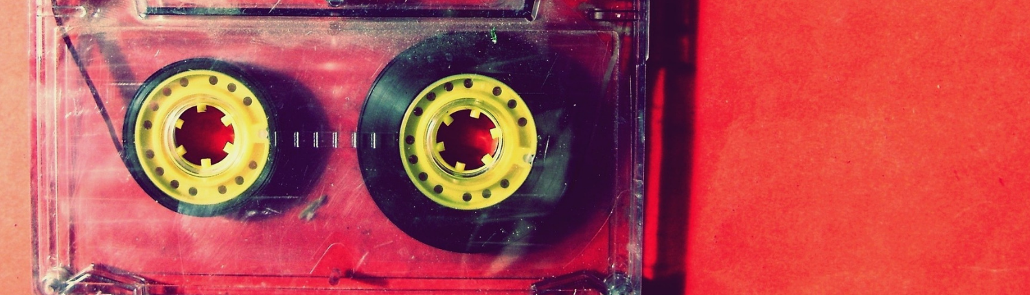 A cassette tape laying on a red background