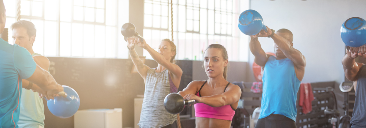 People doing a kettlebell exercise class