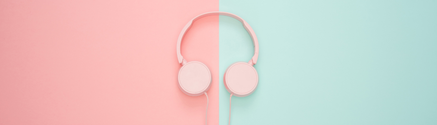A pair of headphones on a pink and blue background